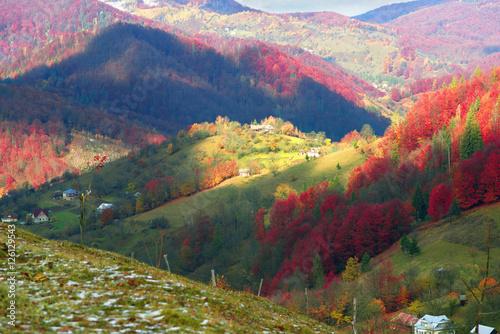 Obraz na Plexi First snow fall in the Carpathian village