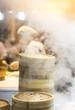 Asian street food - steamed dumplings in Beijing, kitchen interior in China