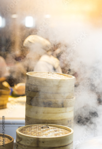 Deurstickers Peking Asian street food - steamed dumplings in Beijing, kitchen interior in China
