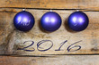 purple christmas balls on a wooden background