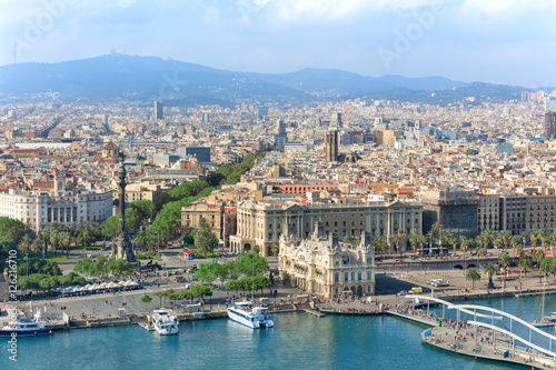 Fotobehang Barcelona Central embankment of Barcelona with Columbus statue, La Rambla street and promenade, Spain