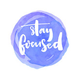 Stay focused. Motivation quote about productivity and concentration on the work and learning. White vector brush lettering saying at blue watercolor stain