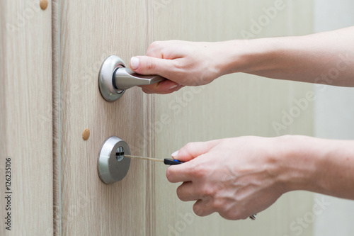 Poster Locking up or unlocking door with key in hand