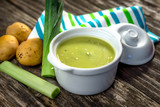 Homemade creamy leek soup on wooden background