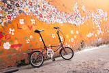 Folding Bike with old wall, Vintage color.