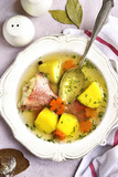 Fish soup with sea perch and vegetables.Top view.