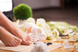 Closeup photo of a female feet at spa salon