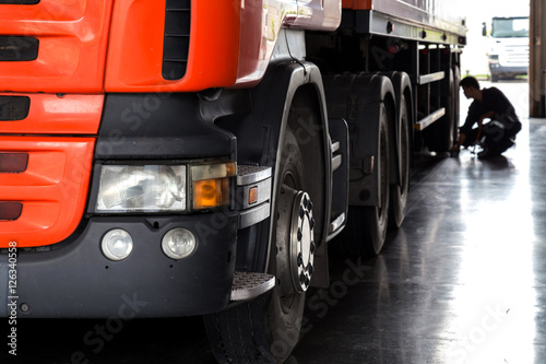 Fototapeta automobile mechanic checking truck in the garage, selective focu