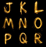 Fototapety Collection of sparkler firework light alphabet.