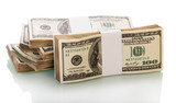 Hundred dollar denominations in bundles closeup isolated on white.
