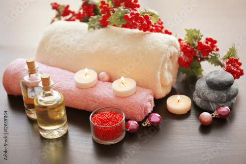 Spa treatment with Christmas decorations on wooden background © Africa Studio