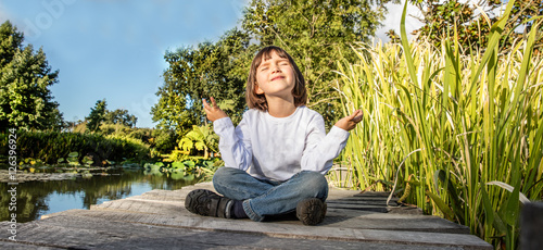 Staande foto Zen smiling young 5-year old yoga child in lotus position