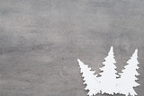 Christmas background. White tree decorations on a gray backgroun