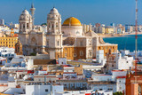 Fototapety Aerial view of the old city rooftops and Cathedral de Santa Cruz in the morning from tower Tavira in Cadiz, Andalusia, Spain