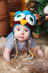 baby in knitted hat owl tree