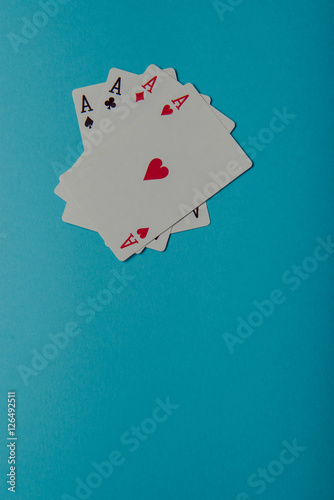 Poster A winning poker hand of four aces playing cards