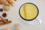 Turmeric latte, Golden milk, Turmeric milk made from turmeric, almond mink, cinnamon, ginger and honey, healthy hipster drink - 126495550