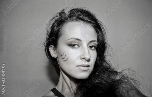 Poster pretty girl with tribal makeup