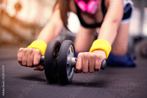 Close up hand,beautiful young women doing pilate exercises in fitness studio,bea Poster
