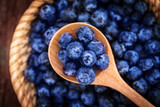 Fototapety close up fresh picked blueberies in wooden spoon