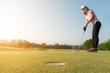 Asian woman golf player putting golf ball on green, golf ball dr
