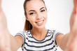 Portrait of a cheerful attractive woman making selfie photo