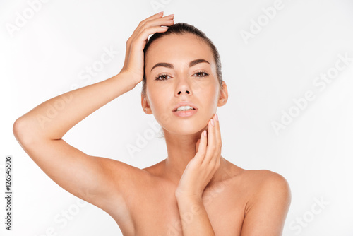 Tela Beauty portrait of a lovely woman with fresh skin standing