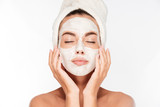 Woman with eyes closed and white facial mask on face
