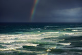 waves in rough sea with stormy clouds and rainbow - 126546504