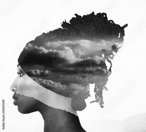 Monochrome double exposure of profile woman portrait and cloudscape - 126551369