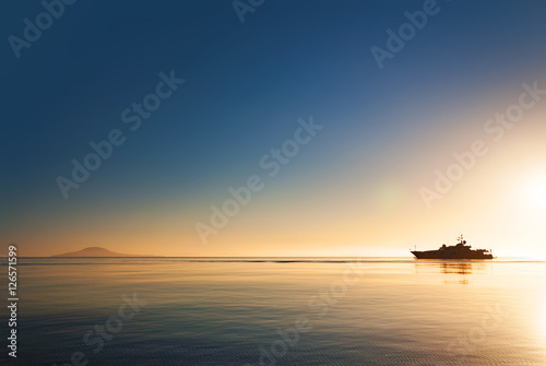 Silhouette of a luxurious yacht on the sea of cortez  at sunset Poster