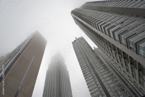 Fotobehang Buenos Aires Downtown skyscrapers under the fog upward view at the Puerto Madero.