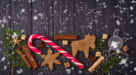 Christmas background with cookies, tree and cinnamon