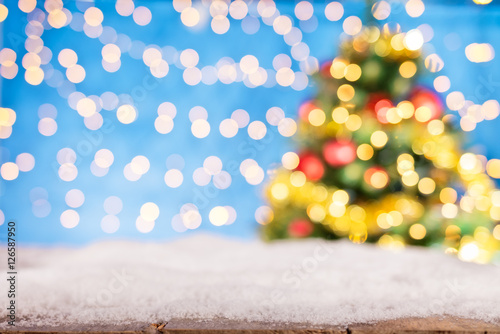 Blurred abstract golden spot lights with christmas tree Poster