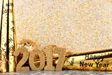 New Years Eve 2017 border of noise makers and golden decor with twinkling light background