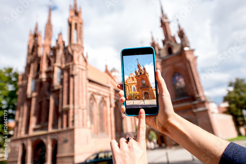 Photographing with smart phone saint Anna gothic church in the old town of Vilni Poster