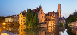 Panorama of Bruges, Belgium. Image with Rozenhoedkaai in Brugge, Dijver river canal and Belfort, Belfry, tower in twilight.