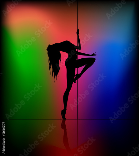 Silhouette of young beautiful woman dancing a striptease
