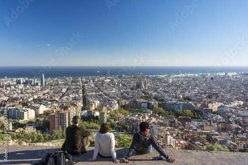 Young people enjoying the view of Barcelona from the Bunker Carmel viewpoint Poster