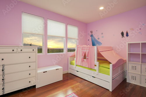Beautiful girls room in bright pink color with furniture, bed and toys. - 126690965