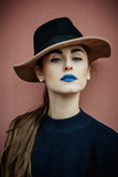Girl with black hat