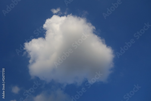 Poster Cloud against clear blue sky background