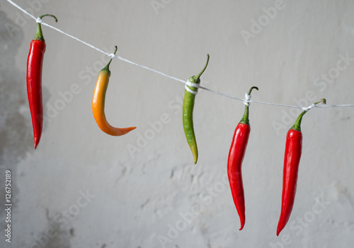 chili peppers on a rope