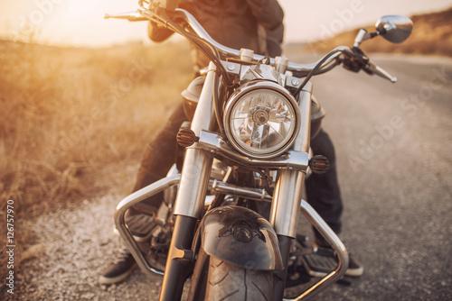Fotobehang Fiets motorbike on asphalt with rider