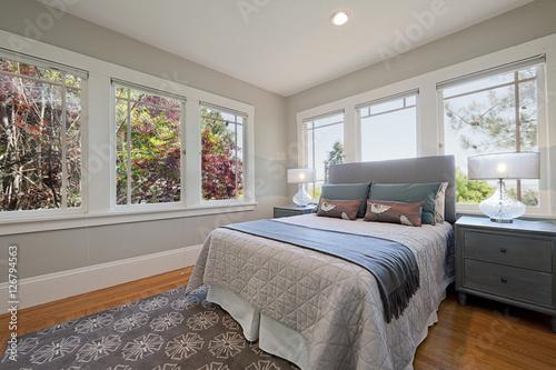 Plagát Interior of white and gray cozy bedroom