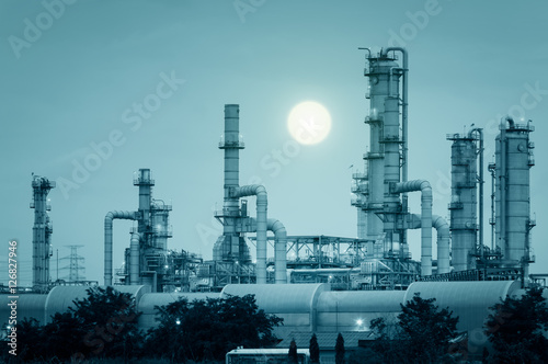 Fotobehang Koraalriffen Oil Refinery factory at Night , petrochemical plant , Petroleum , Chemical Industry green color tone background..