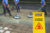Cleaning in process and caution wet floor symbol againt cleaning blur background - 126835573