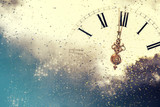 Abstract background with fireworks and clock close to midnight - 126836354