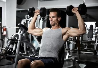 Shoulder bench press workout © Kurhan