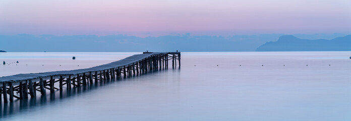 Sunset on the beach with a pier